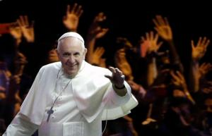 Pope Francis waves to the crowd during a parade Saturday, Sept. 26, 2015, in Philadelphia. The pontiff attended a music-and-prayer festival there Saturday night to close out the World Meeting of Families, a Vatican-sponsored conference of more than 18,000 people from around the world. (AP Photo/Matt Rourke, Pool)